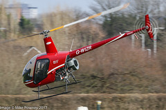 G-WIZR - 1998 build Robinson R22 Beta II, departing Barton to the North