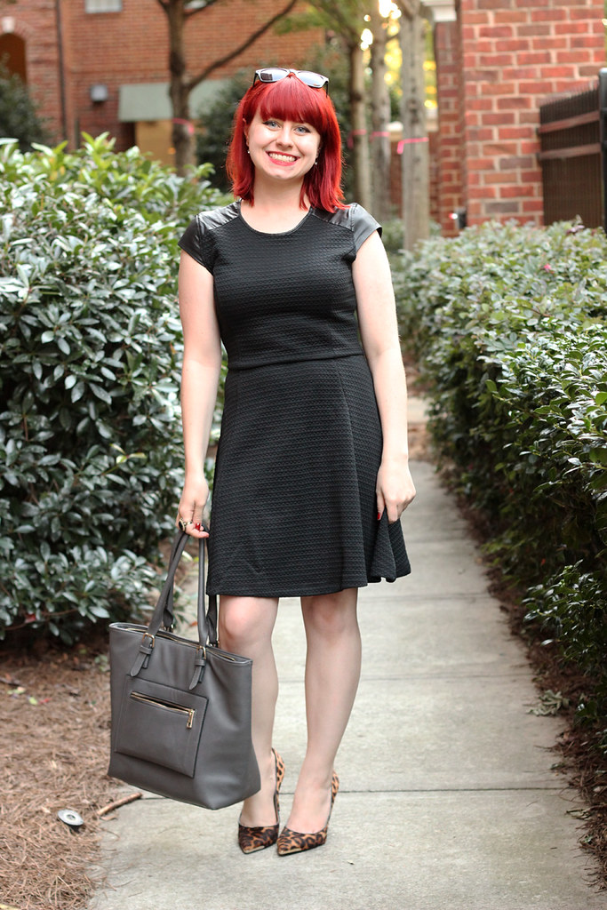 Black Textured Fit and Flare Dress with Leather Cap Sleeves, Leopard Print Heels, and a Gray Tote Bag
