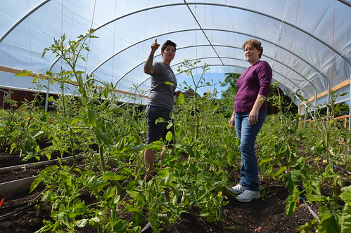 Urban farmer Stacey Givens and Kim Galland from NRCS talking about the benefits of high tunnel