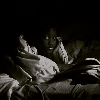 Blac Girl Reading in Bed at Night Black and White Lourdie | by stevendepolo