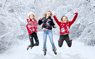 girls jumping in ugly Christmas sweaters | by TheUglySweaterShop