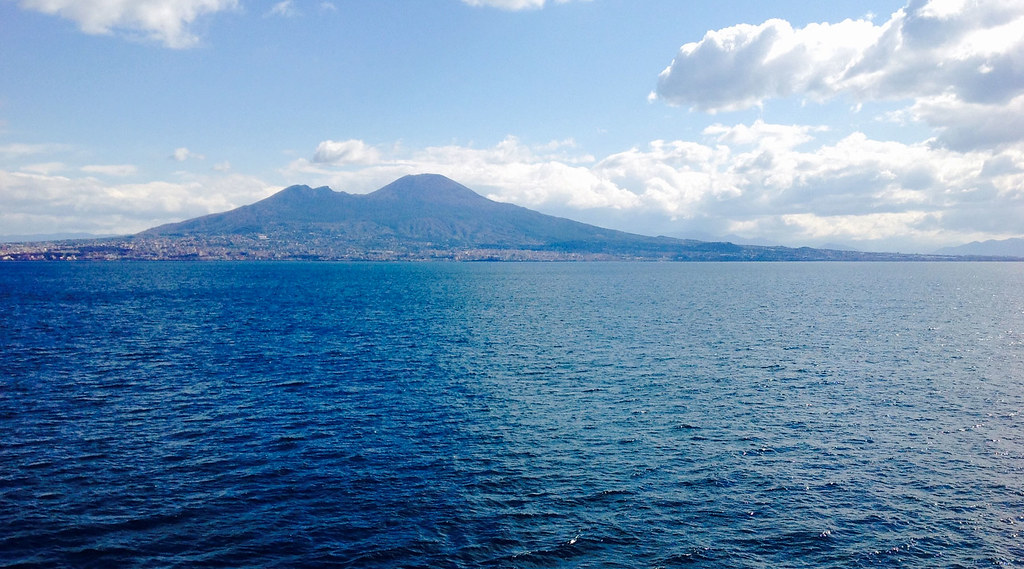 The city of Naples in the shadow of Mount Vesuvius, viewed from the water