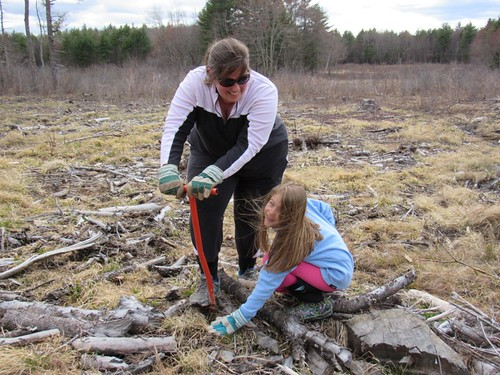A mother and daughter duo enjoying the task of planting hundreds of bare-root native shrubs