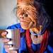 old tamang woman drinking tea