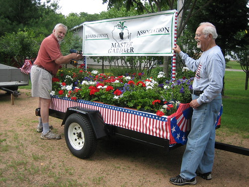 image: men at garden cart