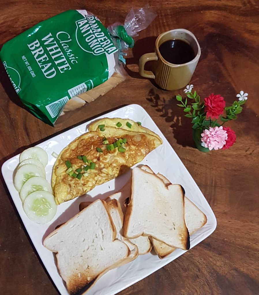 Breads from Panaderia Antonio, Scrambled Egg and coffee are simple yet palatable for the lazy afternoon to be awake.