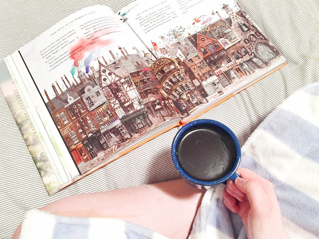 Reading Harry Potter with a cup of coffee