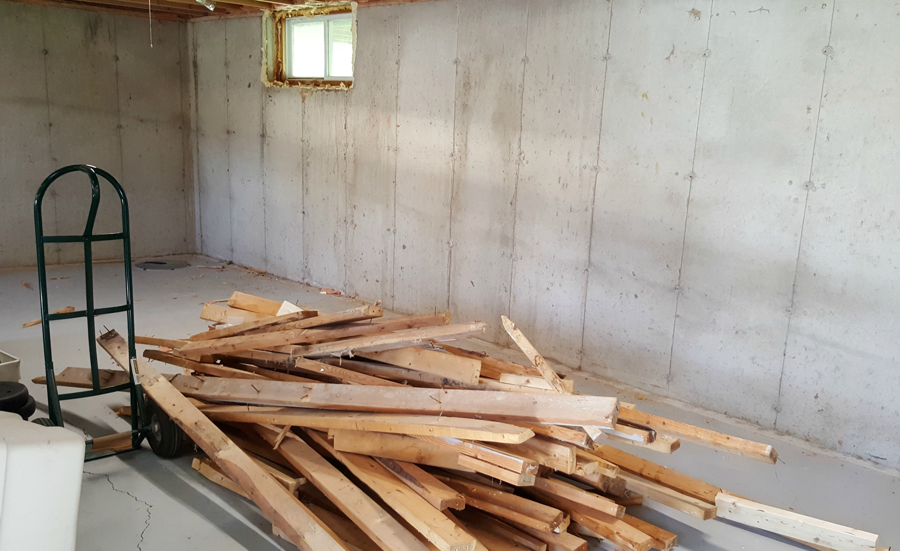 basement framing and spray foam insulation - demo day