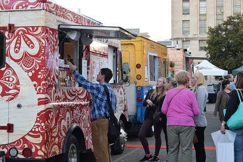 Food trucks with people ordering