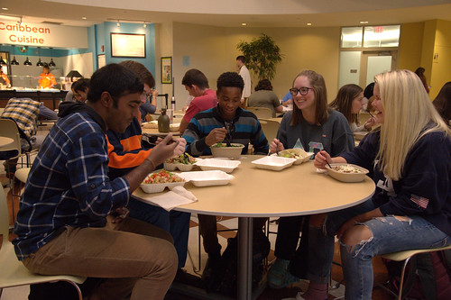 Students enjoy lunch at API, where meals include tilapia and produce harvested from the aquaponics project.