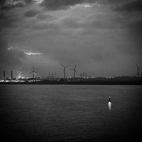 Energy by Night... #green #energy #river #hamburg #wind #greenenergy #blackandwhite #black #white #contrast #water #clouds #night #photo #nikon #germany #igers #photography #picture #followme #follow4follow #follow #followforfollow #picture #photooftheday | by ReflectionPhotographers