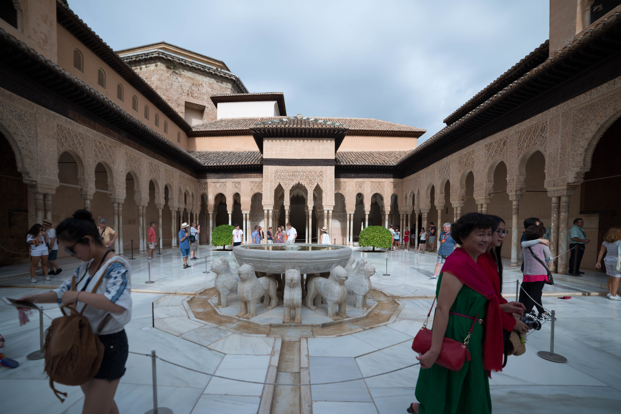 Two tourists going in opposite directions Alhambra Granada Spain