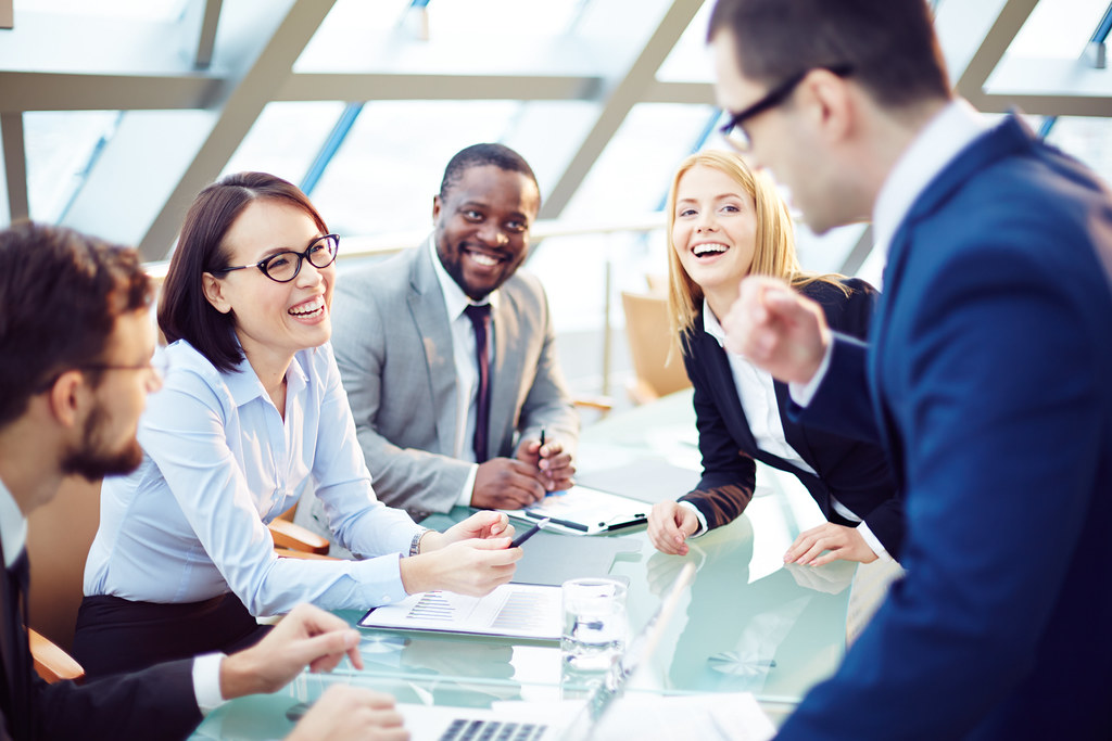 Group of people talking around a boardroom table
