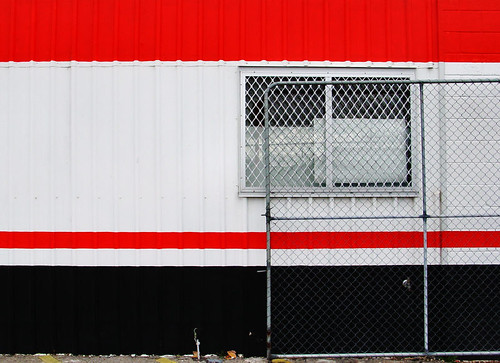 chainlink gate on red white and black | by Janet Leadbeater