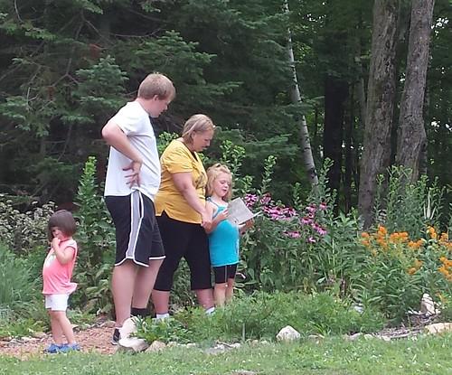 image: family exploring garden