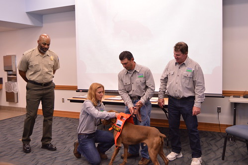 APHIS Wildlife Services program specialist Mario Eusi and his dog Cain at their graduation ceremony