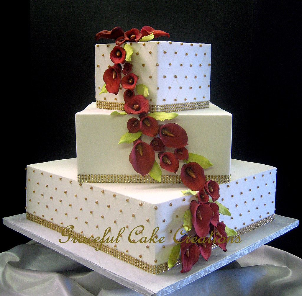 Elegant Square Ivory Butter Cream Wedding Cake with Gold P