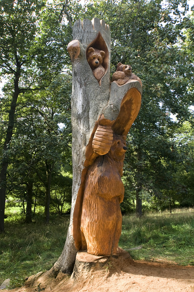 A chainsaw sculpture of mother bear and her cubs in bishop