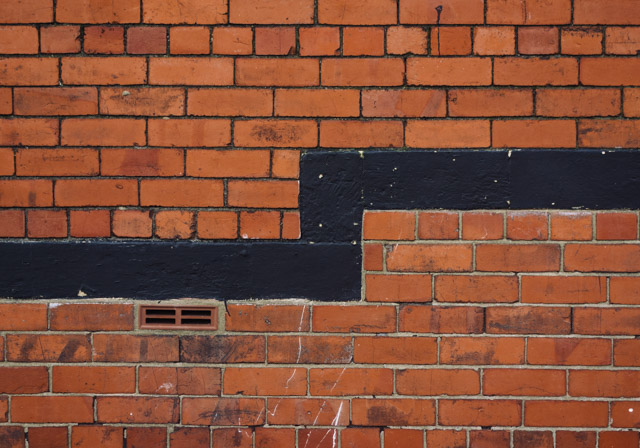 black split brick wall