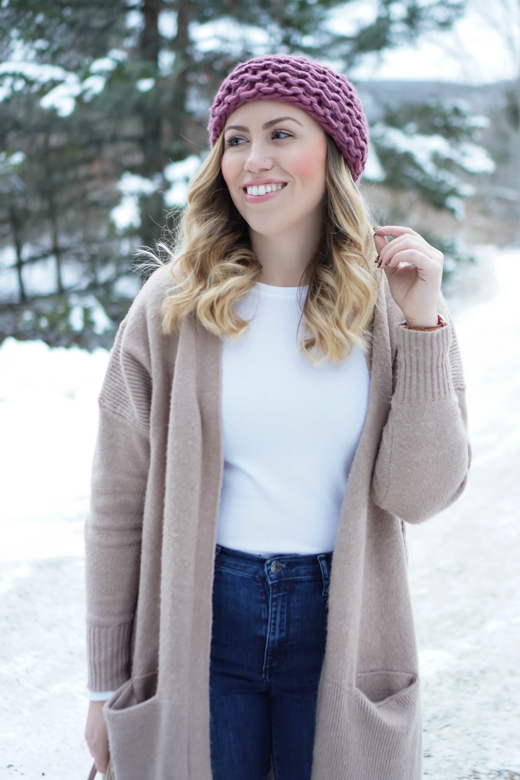 Casual Winter Pastel Outfit Pink Pom Pom Beanie and Camel Oversized Sweater Gap High Waisted Jeans