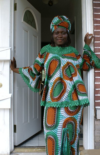 Sierra Leone A neighbor in traditional dress. Her pose was… Flickr