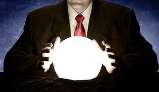 Businessman Consulting Glowing Crystal Ball | by InfoWire.dk