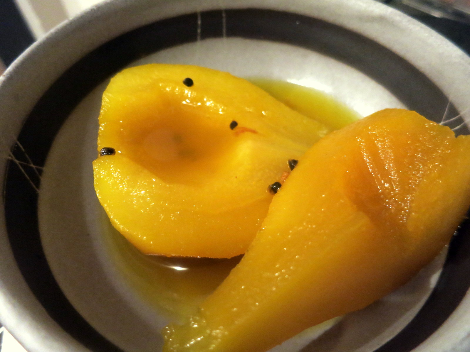 Pears poached in white wine with saffron and cardamom