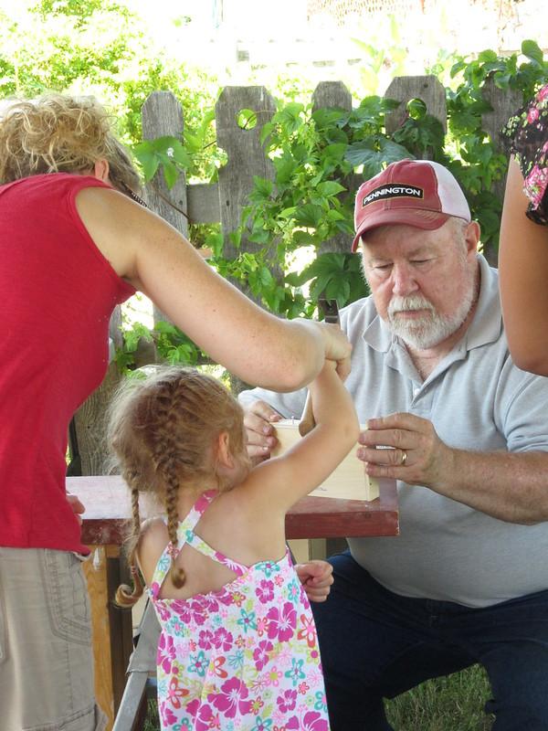 image: man helping child
