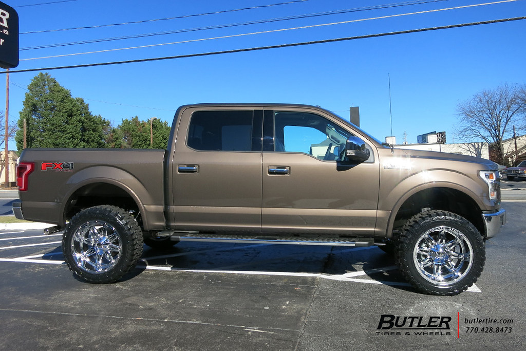 ford f150 with 22in fuel hostage wheels and toyo open country mt tires with 6in pro