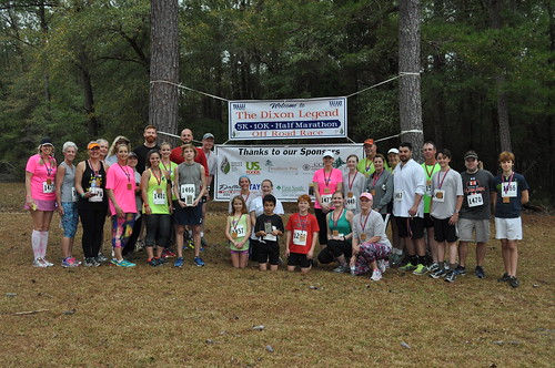 A group of runners of all ages is gathered for the start of the 2016 off-road race at the Solon Dixon Forestry Education Center in Andalusia.
