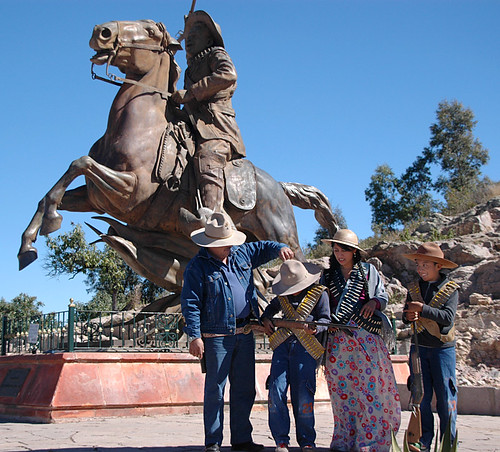 A family of revolutionaries get ready to pose in front of a statue of Pancho Villa on the the Bufa, the highest point in Zacatecas, Mexico