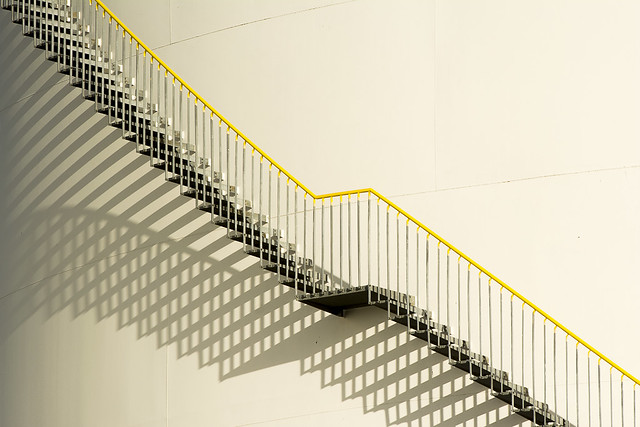Yellow handrail and shadows