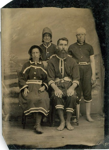 Strange family, late 1800s?   A tintype of an extended famil ...