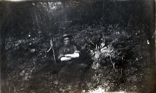 McWilliam having a quiet smoke in a shell-hole