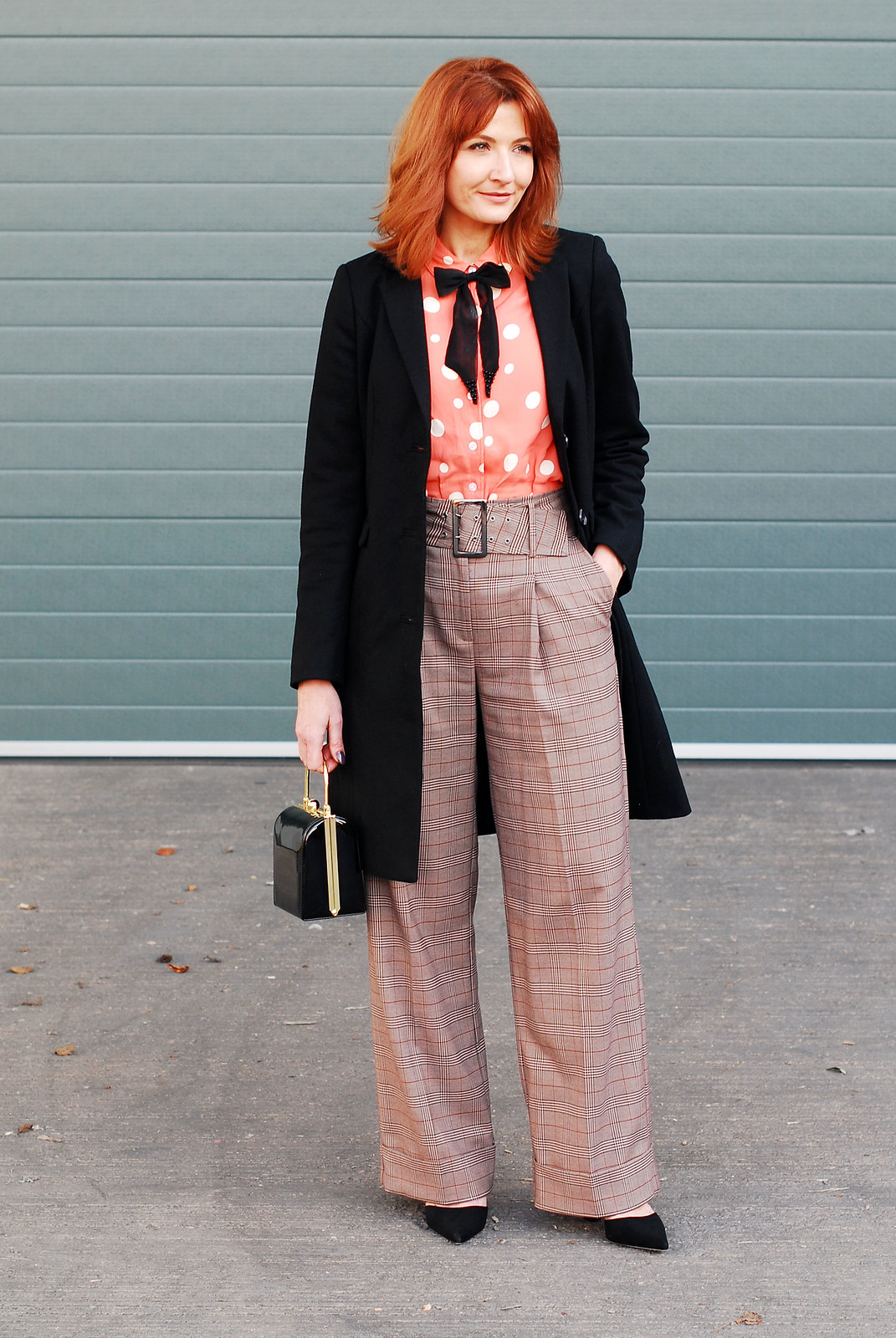 How to get the Katharine Hepburn look: Wide leg check turn up trousers \ masculine-cut black coat \ polka dot blouse with embellished black bow neck tie \ black box handbag \ cone-heeled black pointed shoes | Not Dressed As Lamb, over 40 style