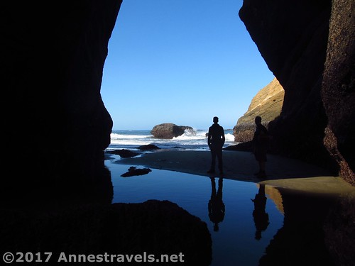 Looking through a sea arch from within the Punchbowl at low tide, Oregon