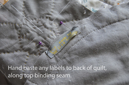8. (optional) Hand-baste with a couple stitches any sew-on care labels.