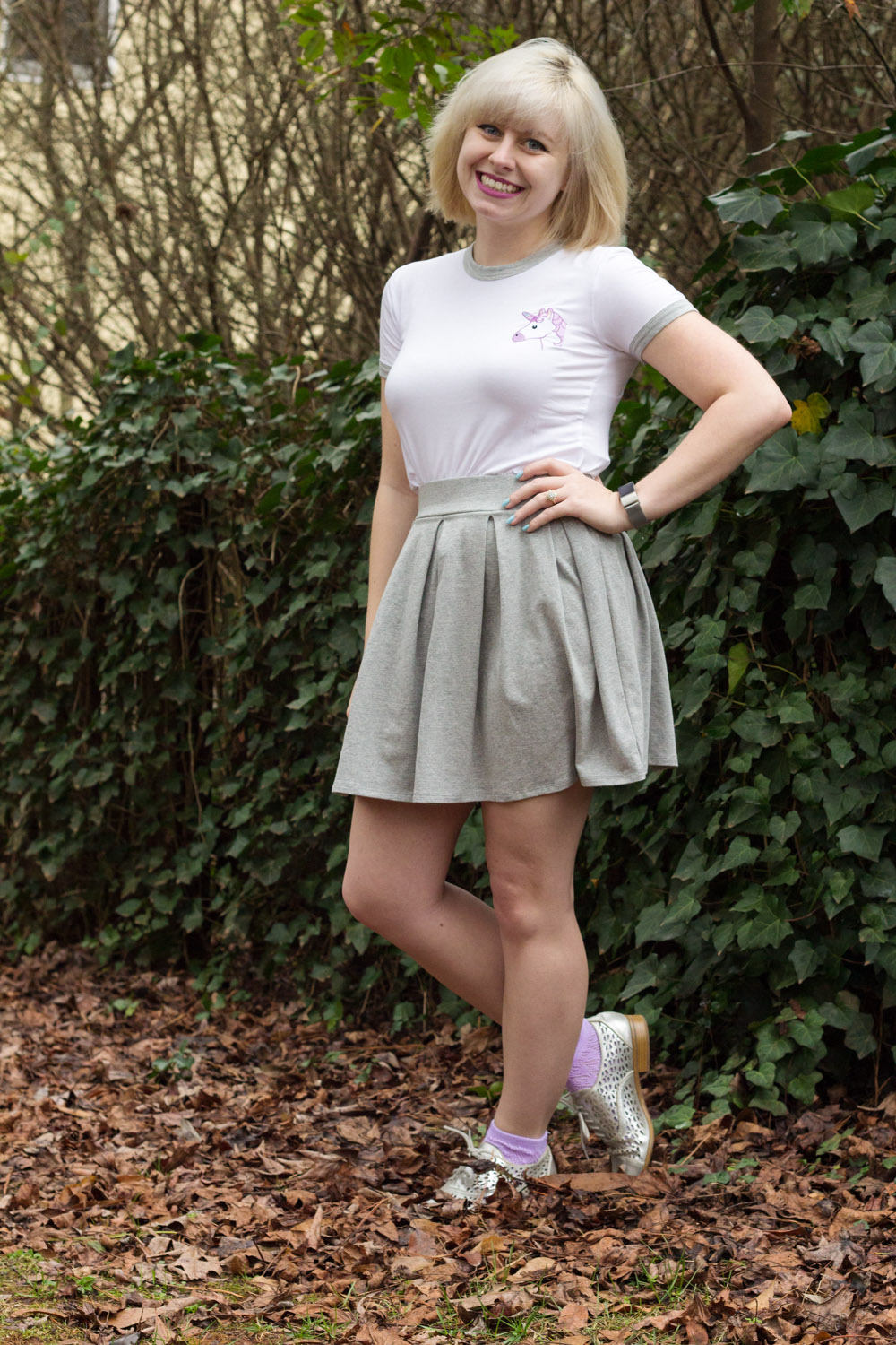 Embroidered F21 Unicorn Shirt, Pleated Jersey Knit Skirt, Silver Shoes, and Purple Socks