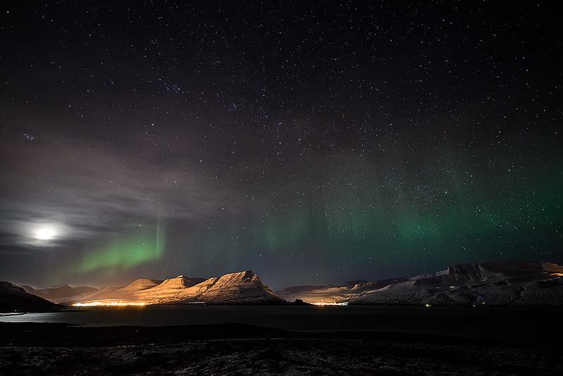 Aurora over fjord Reyðarfjörður (Iceland)