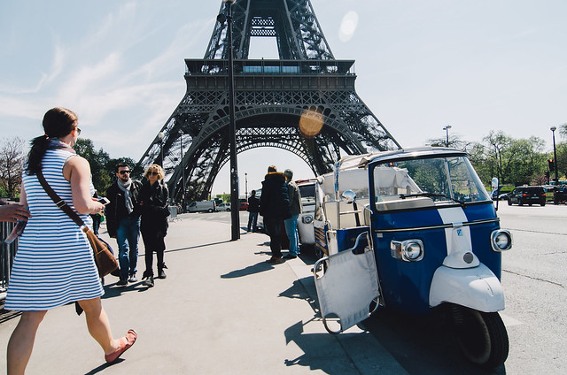 Petty cabs ready for riders at the Eiffel Tower.
