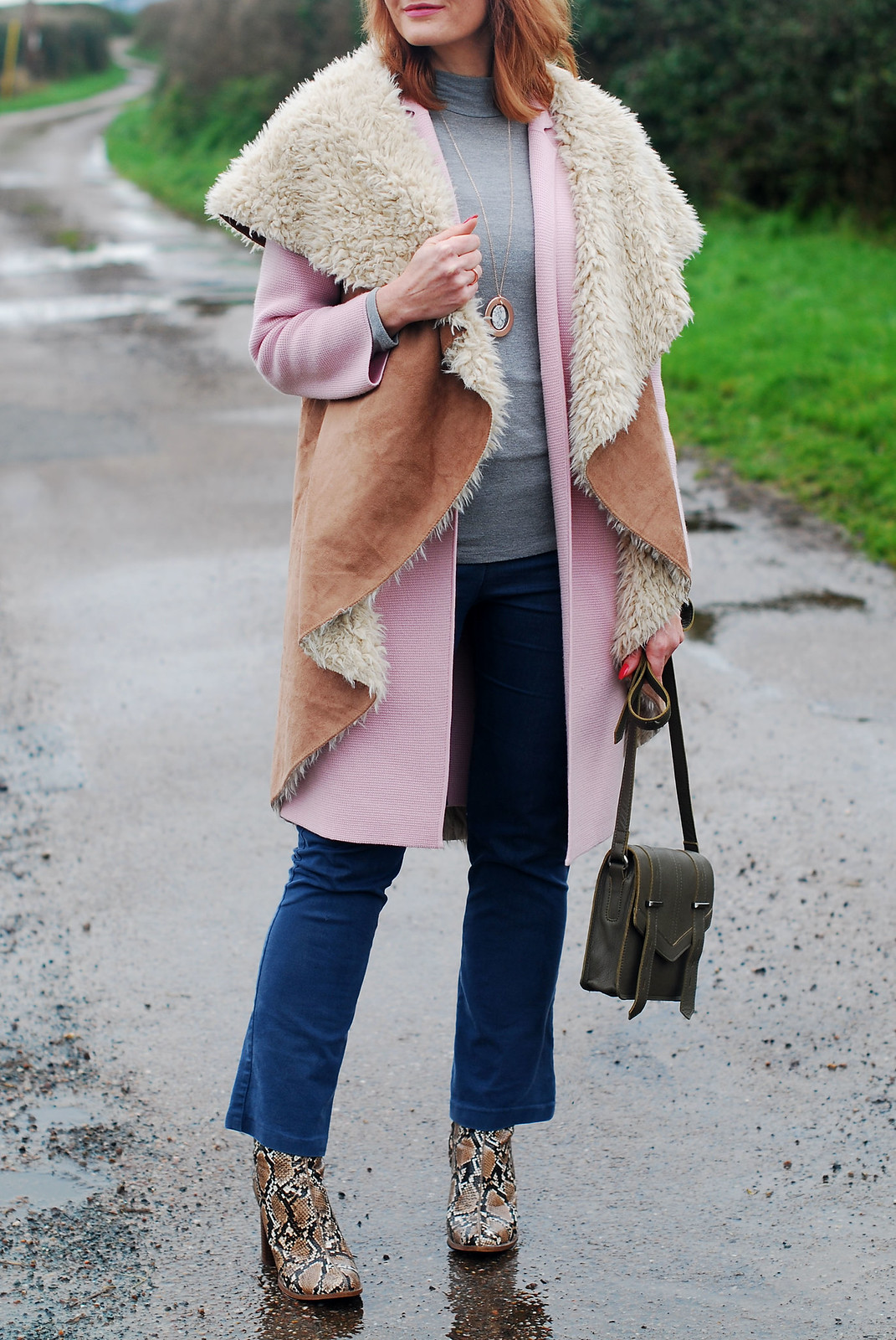 Layered winter outfit  oversized faux shearling gilet  pink coatigan  grey roll neck  flared denim trousers  snakeskin ankle boots | Not Dressed As Lamb, over 40 style
