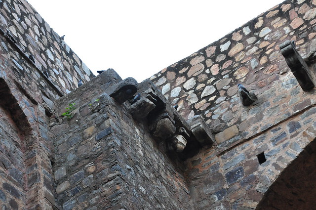 Crumbling stones at the top--are these remnants of a pulley system for drawing water from the 'baoli'?