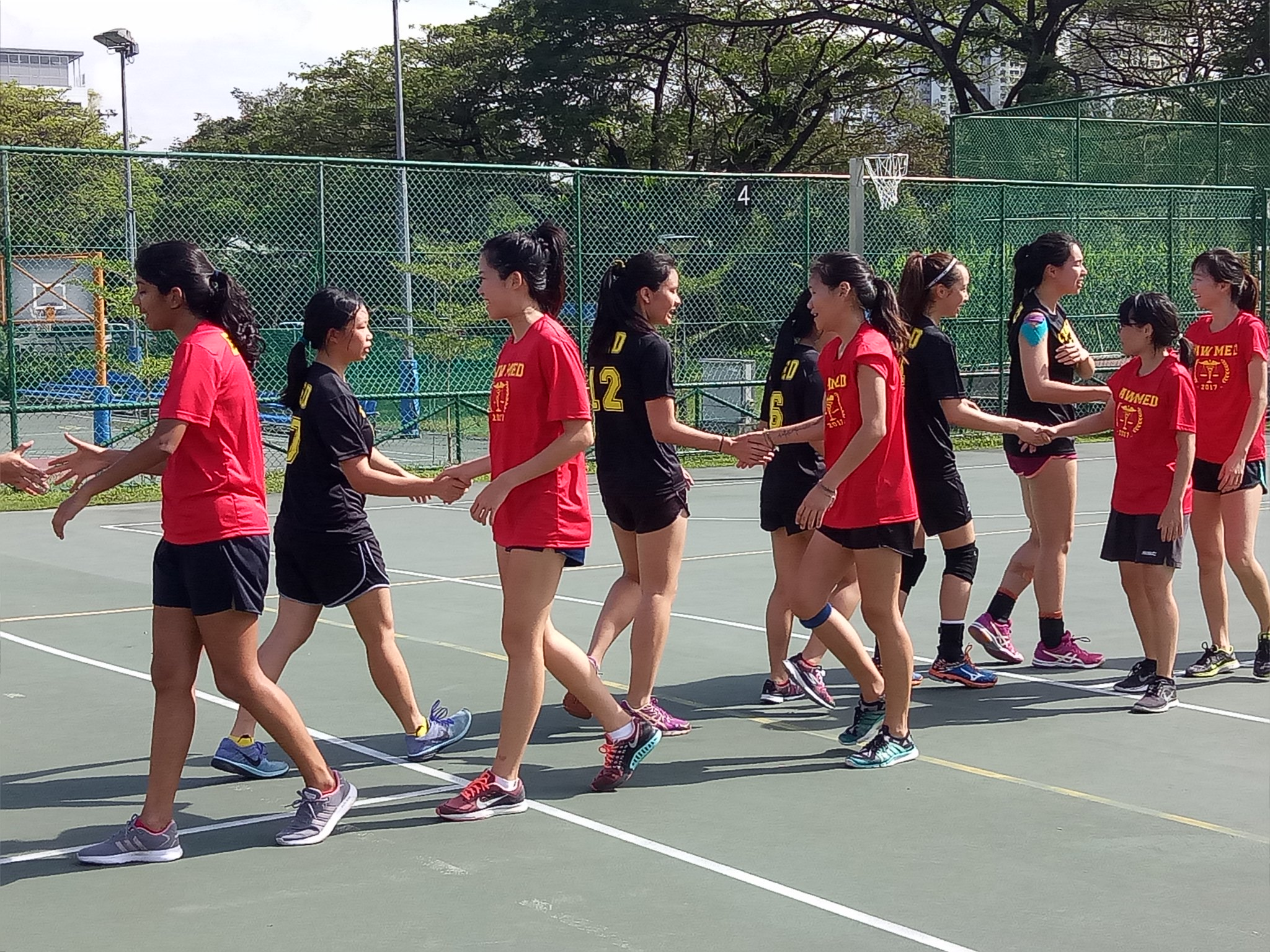 Shaking hands with the opponents after the match, thanking one another for a great game played.