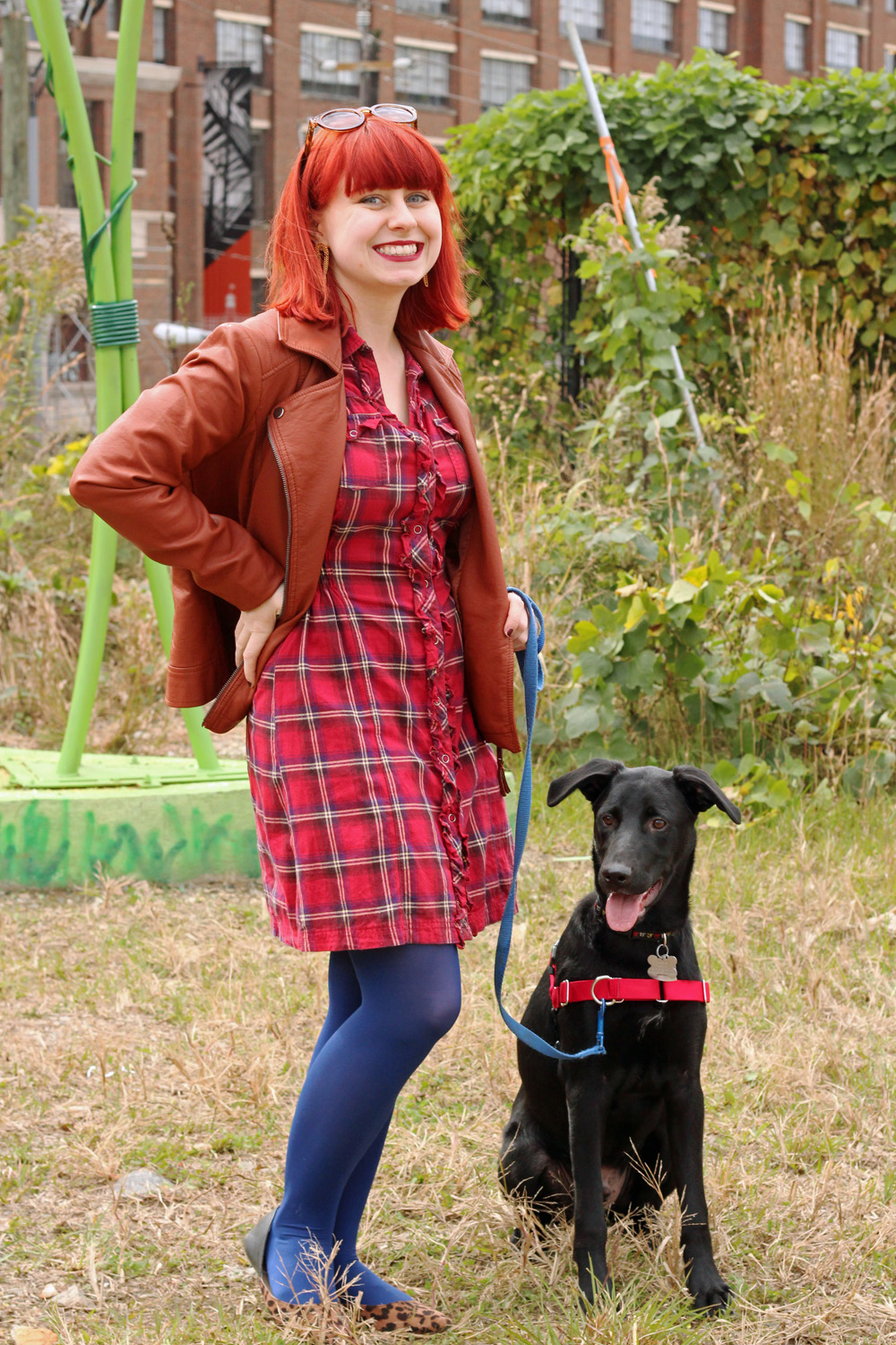 Wearing a Red Plaid Dress with Leopard Print Flats, a Faux leather Jacket, and Blue Tights
