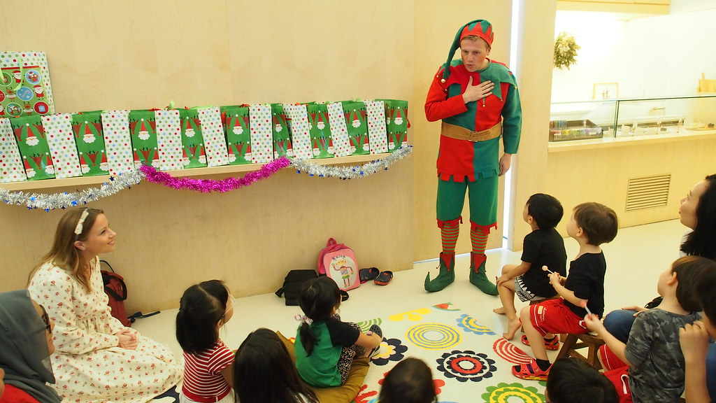 One of Santa's elves, asking the children whether they have written their letters to Santa.