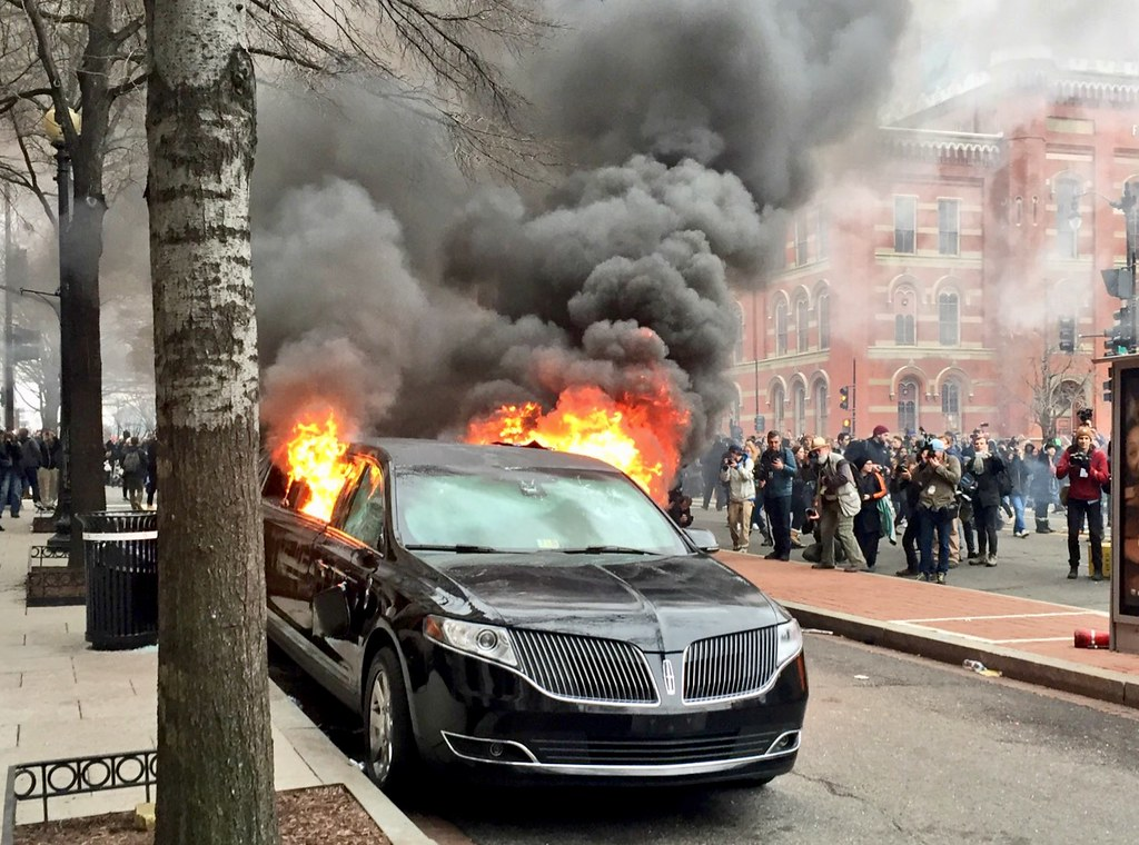 inauguration protesters set limo on fire
