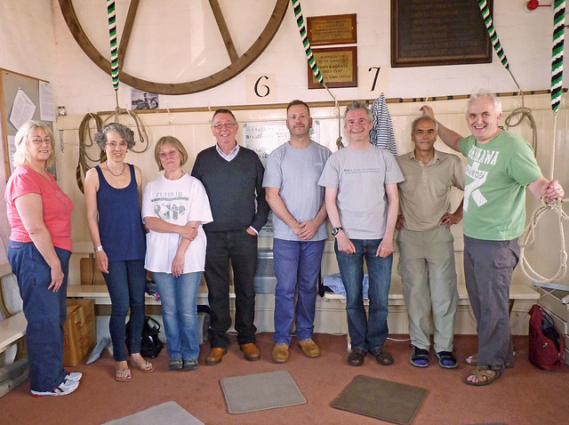 Group photo of peal ringers lined up with treble ringer on left and tenor on right