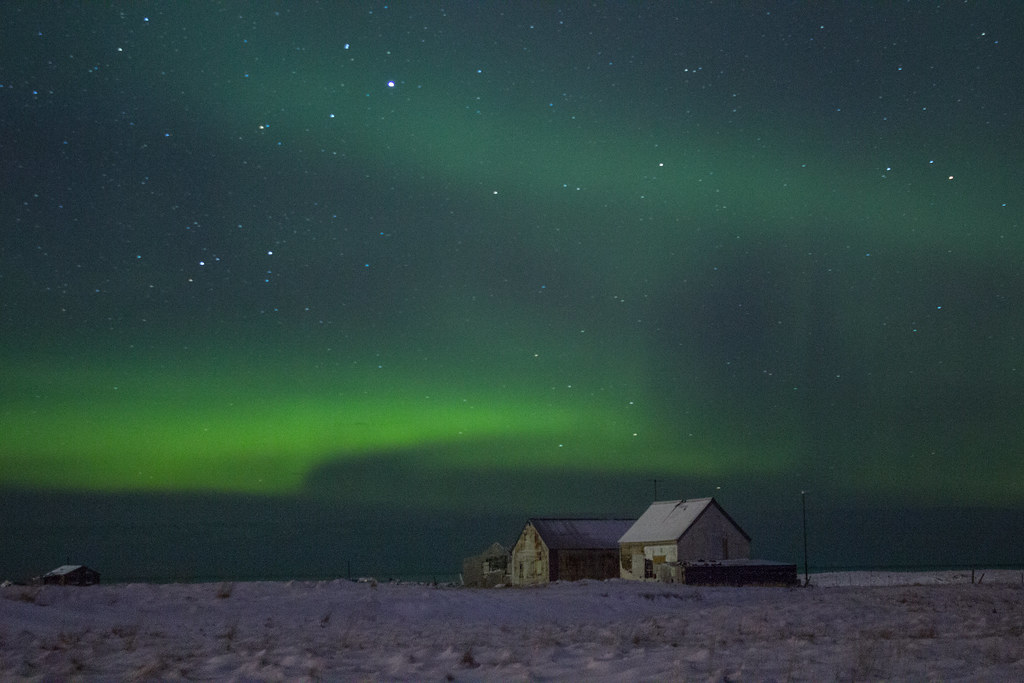 The aurora borealis over a farmhouse in Iceland