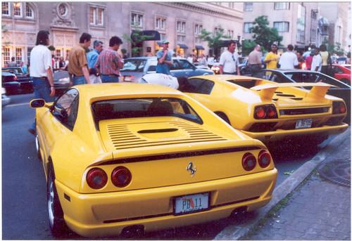 The Tail Ends Of A Ferrari F 355 And A Lamborghini Diablo