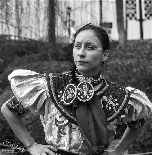 Image of the face of a Native American dancer wearing a Jingle Dress